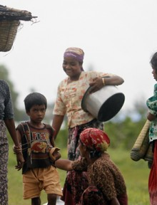Rohingya Muslims carry their belongings as they move after recent violence in Sittwe